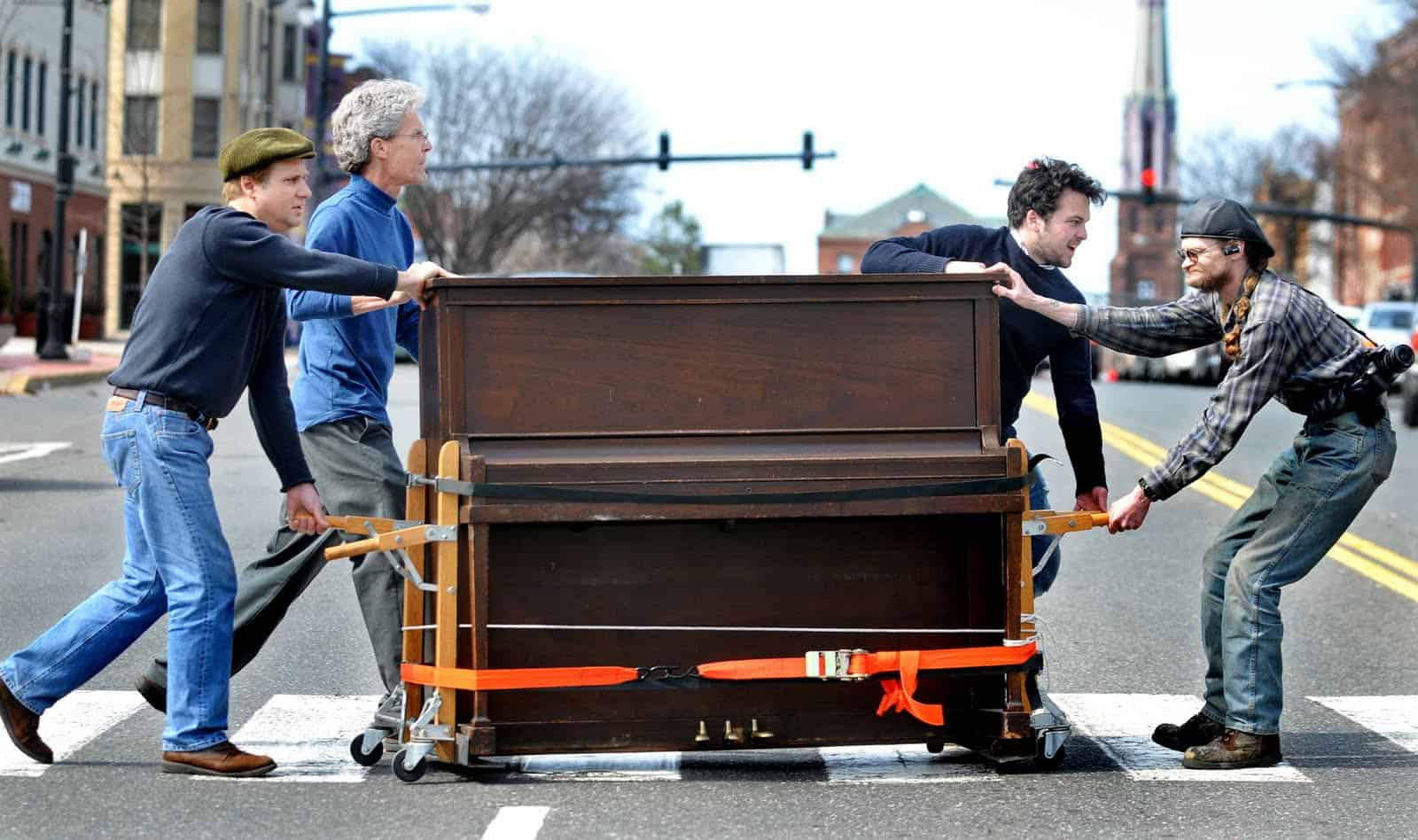 People Moving Piano from one Place to Another