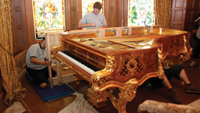 People Fixing & Installing Piano