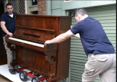 People Moving Piano
